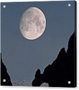 Gibbous Moon Rising Over A Coastal Cliff Acrylic Print
