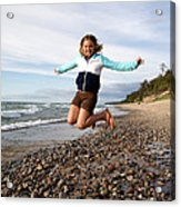 Girl Jumping At Lake Superior Shore Acrylic Print