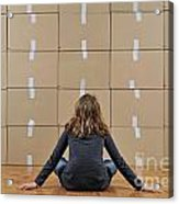 Girl Seated In Front Of Cardboard Boxes Acrylic Print