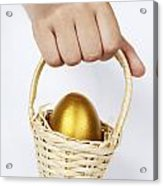 Girl's Hand Holding Basket With Golden Egg Acrylic Print