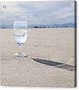Glass Of Water On Dried Mud Acrylic Print by Thom Gourley/Flatbread Images, LLC