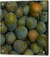 Green Plums Fill A Bin Outside A Local Acrylic Print