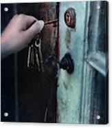 Hand Putting Vintage Key Into Lock Acrylic Print