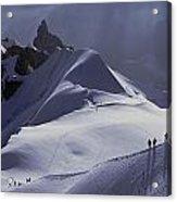 Hikers Follow Paths Across The Snow Acrylic Print