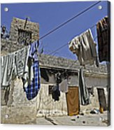Laundry Hangs In The Courtyard Acrylic Print by Stocktrek Images