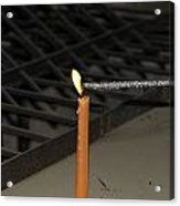 Lighting A Sparkler With An Orange Candle Acrylic Print