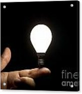 Lit Light Bulb Balancing On Finger Acrylic Print
