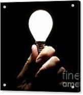 Lit Lightbulb Held In Hand Acrylic Print