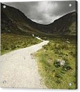Lone Person Walking On A Path Leading Acrylic Print