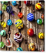 Marbles On Wooden Board Acrylic Print