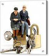 Miniature Figurines Of Elderly Couple Sitting On Padlocks Acrylic Print by Bernard Jaubert
