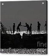People Walking On Rocks By The Water Acrylic Print