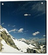 Person Dangles From A Helicopter Acrylic Print by Michael Melford