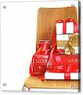 Pile Of Gifts On Wooden Chair Against White Acrylic Print
