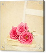 Pink Roses Laying On A Book Acrylic Print