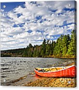 Red Canoe On Lake Shore Acrylic Print