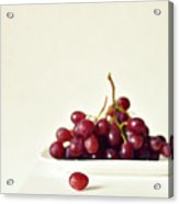 Red Grapes On White Plate Acrylic Print by Photo by Ira Heuvelman-Dobrolyubova