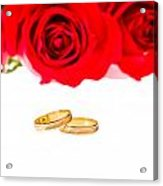 Red Roses And Wedding Rings Over White Acrylic Print
