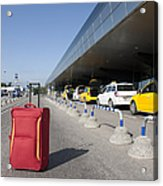 Rolling Luggage Outside An Airport Terminal Acrylic Print