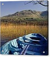 Row Boat Amongst Reeds On A Lake Acrylic Print