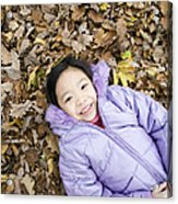 Smiling Girl Lying On Autumn Leaves Acrylic Print