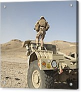 Soldier Climbs A Damaged Husky Tactical Acrylic Print by Stocktrek Images