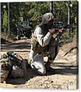 Soldier Provides Security To A Casualty Acrylic Print