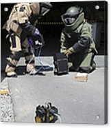 Soldiers Dressed In Bomb Suits Examine Acrylic Print