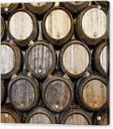 Stacked Oak Barrels In A Winery Acrylic Print by Marc Volk