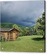Storm Clouds Form Above A Log Cabin Acrylic Print
