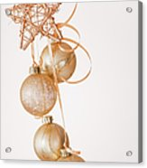 Studio Shot Of Gold Christmas Ornaments Acrylic Print by Daniel Grill
