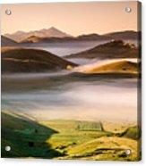 Sunrise In Castelluccio Di Norcia In Morning Fog Acrylic Print
