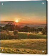 Sunset Over Countryside Acrylic Print by Verity E. Milligan