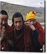 Three Buddhist Lamas In Gansu Province Acrylic Print by David Edwards