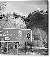 tourist sign for glencoe visitors centre in glen coe highlands Scotland uk Acrylic Print