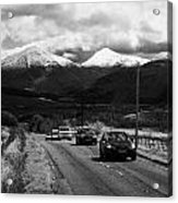 Traffic On A82 Trunk Road Through The Scottish Highlands With Snow Covered Mountains Ben More  Acrylic Print