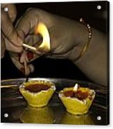 Trying To Light An Oil Lamp That Has Gone Out Acrylic Print