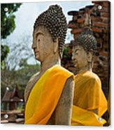 Two Buddha Statues Wrapped In An Orange Scarf  Acrylic Print