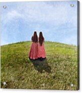 Two Girls In Vintage Dresses Walking Up Grassy Hill Acrylic Print