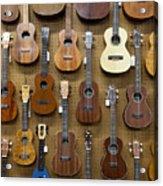 Various Guitars & Ukuleles Hanging From Wall Acrylic Print