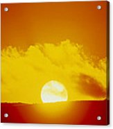 View Of The Sun Setting Behind A Cloud Acrylic Print