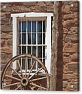 Window In Stone Building With Wagon Wheel Acrylic Print by Thom Gourley/Flatbread Images, LLC