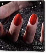 Woman Hand With Red Nail Polish Buried In Black Sand Acrylic Print