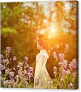 Woman Staning Sideways In Garden At Sunset Acrylic Print