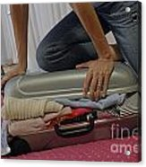 Woman Trying To Close Overflowed Suitcase On Bed Acrylic Print