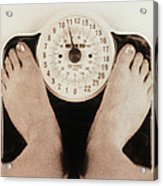 Woman's Feet On A Set Of Weighing Scales Acrylic Print
