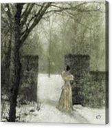 Young Lady By Stone Pillar In Snow Acrylic Print