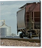 A Lone Grain Hopper Stands Idle On The Tracks Acrylic Print