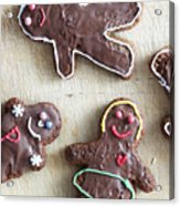 Handmade Decorated Gingerbread People Lying On Wooden Table Acrylic Print