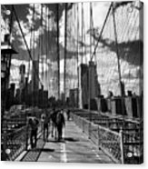 people walking over the brooklyn bridge between cables towards lower manhattan New York City USA Acrylic Print